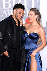 Alex Oxlade-Chamberlain and Perrie Edwards attending the Brit Awards 2019 at the O2 Arena, London. Photo credit should read: Doug Peters/EMPICS Entertainment. EDITORIAL USE ONLY