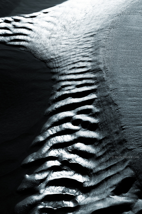 Abstract of sand patterns at low tide at Aberffraw beach, West Anglesey