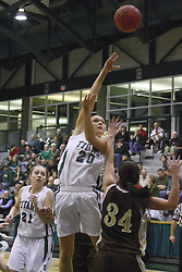 17 December 2011:  Whitney Scurlock takes a modified hook shot over Ashley Teresiak  during an NCAA womens division 3 basketball game between the St. Francis Fighting Saints and the Illinois Wesleyan Titans in Shirk Center, Bloomington IL