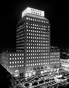 Y-541203-02. Pacific Power & Light building exterior at night. New sign on building. December 3, 1954