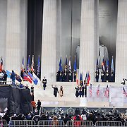 "President-elect Barack Obama and First Lady Michelle Obama walk down the steps of the Lincoln Memorial as thousands cheer during the ""We Are One: The Obama Inaugural Celebration At The Lincoln Memorial"" on January 18, 2009 at the National Mall in Washington, DC."