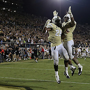 ORLANDO, FL - OCTOBER 09: Clayton Geathers #26 and Troy Gray #57 of the UCF Knight celebrate their 31-24 overtime win over BYU at Bright House Networks Stadium on October 9, 2014 in Orlando, Florida. (Photo by Alex Menendez/Getty Images) *** Local Caption *** Clayton Geathers; Troy Gray