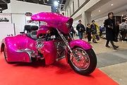 A pink three-wheeled touring motorcycle at the 44th annual Tokyo Motorcycle show. Tokyo Big Sight exhibition hall, Odaiba, Tokyo, Japan. Friday March 24th 2017. The show runs from Friday March 24th to Sunday March 26th and showcases technological innovations from all the main motorcycle manufacturers along with companies providing protective helmets pads and  clothing to decoration and even camping gear for bike-touring..