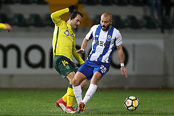 March 11, 2018 - Pacos Ferreira, Pacos Ferreira, Portugal - Porto's Portuguese midfielder Andre Andre (R) vies with Pacos Ferreira's midfielder Ruben Micael (L) during the Premier League 2017/18 match between Pacos Ferreira and FC Porto, at Mata Real Stadium in Pacos de Ferreira on March 11, 2018. (Credit Image: © Dpi/NurPhoto via ZUMA Press)