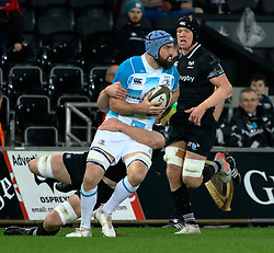 Leinster's Scott Fardy is tackled by Ospreys' Bradley Davies<br /> <br /> Photographer Simon King/Replay Images<br /> <br /> Guinness PRO14 Round 19 - Ospreys v Leinster - Saturday 24th March 2018 - Liberty Stadium - Swansea<br /> <br /> World Copyright © Replay Images . All rights reserved. info@replayimages.co.uk - http://replayimages.co.uk