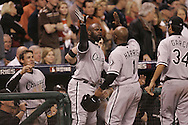HOUSTON - OCTOBER 26:  Teamates greet Willie Harris #1 of the Chicago White Sox after Harris scored the game winning and World Series winning run in the eighth inning during Game 4 of the 2005 World Series against the Houston Astros at Minute Maid Park on October 26, 2005 in Chicago, Illinois.  The White Sox defeated the Astros 1-0.