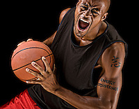 African american basketball player playing strong.