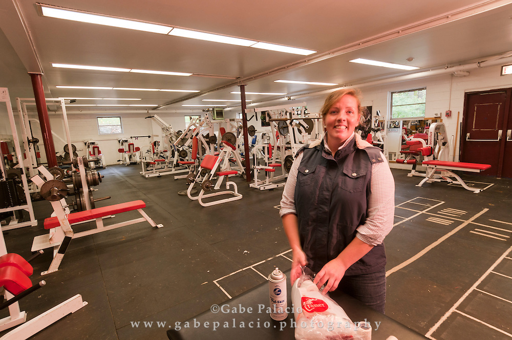Trainer Sarah Yerkes in the weight room of the Harvey School prior to a football game on October, 16, 2010.  (photo by Gabe Palacio)