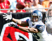 Seattle Seahawks wide receiver D.J. Hackett dives for a pass during the Seattle Seahawks 23-7 victory over the Tampa Bay Buccaneers on December 31, 2006 at Raymond James Stadium in Tampa, Florida.