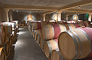 Oak barrel aging and fermentation cellar. Chateau Bellefont Belcier, Saint Emilion, bordeaux, France