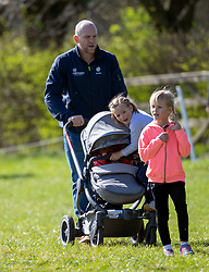 Mike Tindall with his daughters Mia (centre) and Lena Elizabeth (in buggy) and with Isla Phillips (right) at the Land Rover Gatcombe Horse Trials, on Gatcombe Park, Gloucestershire.