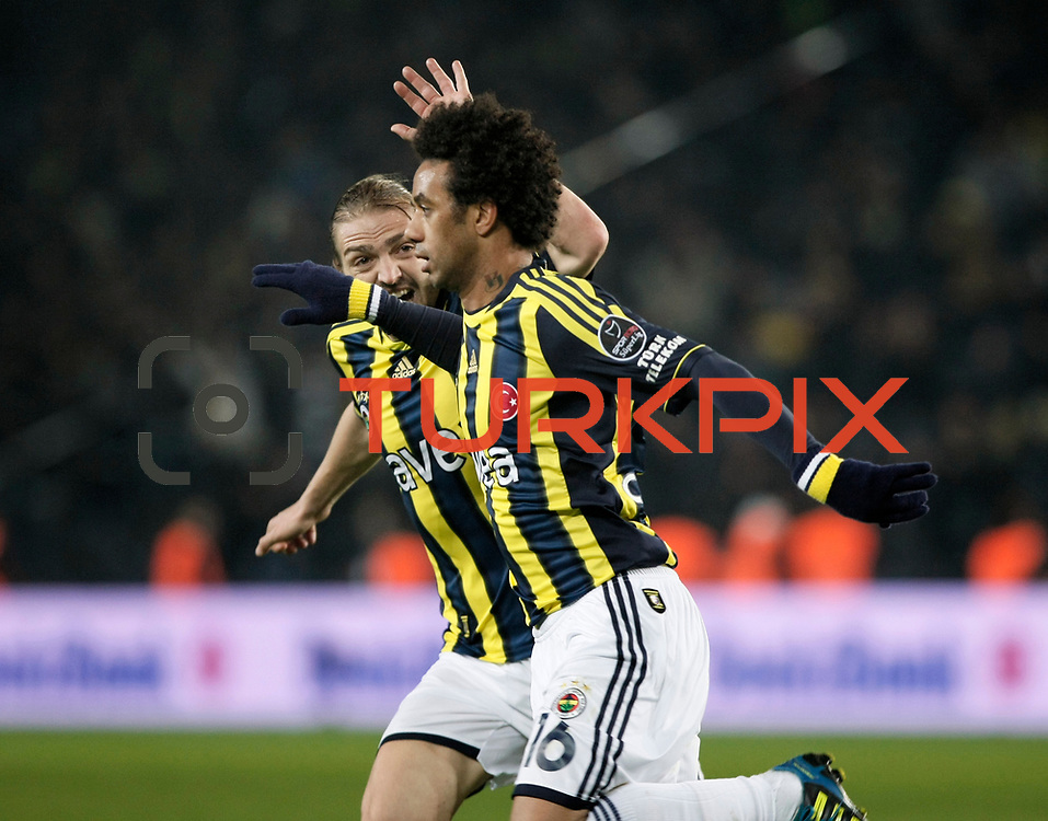 Fenerbahce's Cristian Oliveira Baroni (R) celebrate his goal during their Turkish superleague soccer match Fenerbahce between Gaziantepspor at the Sukru Saracaoglu stadium in Istanbul Turkey on Monday09 January 2011. Photo by TURKPIX