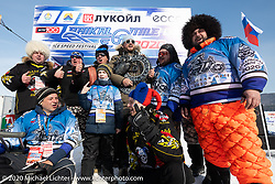 Alexander Pikalo and friends present an award to event promoter Dmitry Khitrov on the main stage of the Baikal Mile Ice Speed Festival. Maksimiha, Siberia, Russia. Saturday, February 29, 2020. Photography ©2020 Michael Lichter.