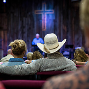 """The Wolgemuth Bros. harvest crew attend """"Cowboy Church"""" in Crowell, TX, May 28, 2017. Every Sunday no matter what town they are in the crew of devout Christians attends church."""