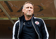 Crawley Town Manager Mark Yates watches from the dugout during the Sky Bet League 2 match between Crawley Town and Leyton Orient at the Checkatrade.com Stadium, Crawley, England on 10 October 2015. Photo by Bennett Dean.