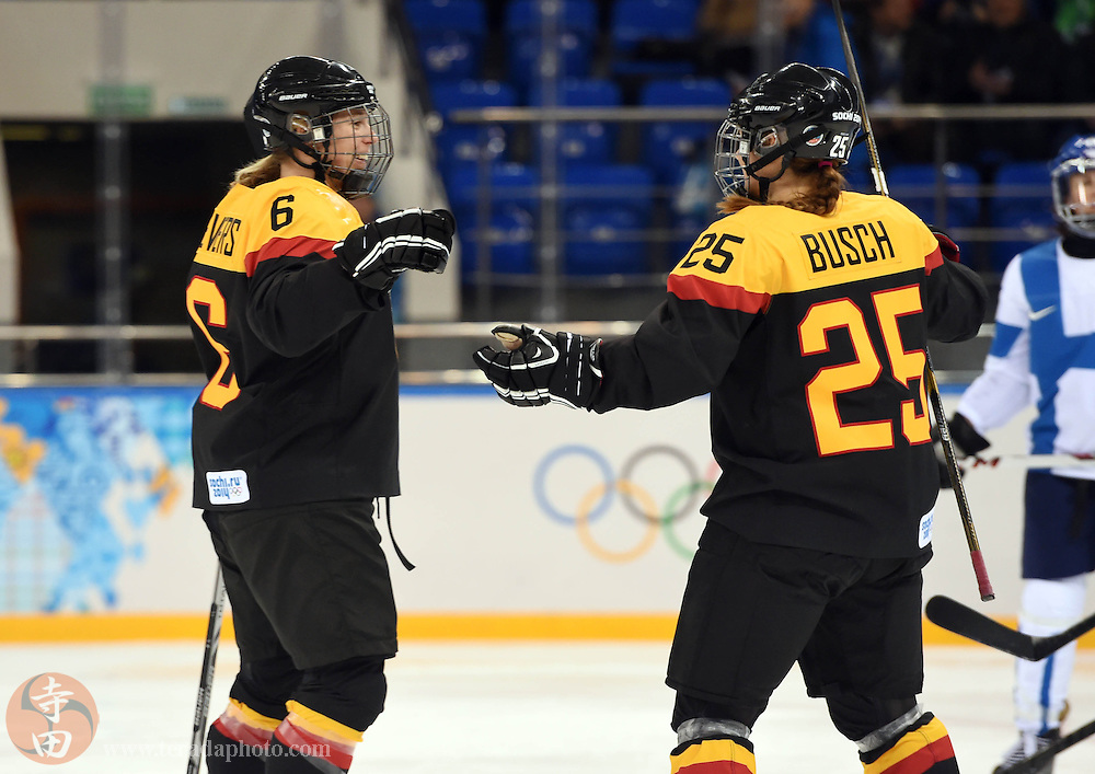 Feb 16, 2014; Sochi, RUSSIA; Germany forward Bettina Evers (6) is congratulated by forward Franziska Busch (25) after scoring a goal against Finland in the women's ice hockey classifications round during the Sochi 2014 Olympic Winter Games at Shayba Arena.