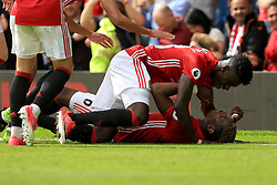 21 May 2017 - Premier League Football - Manchester United v Crystal Palace - Axel Tuanzebe of Manchester United dives on Paul Pogba of Manchester United after the second goal (2-0) - Photo: Paul Roberts / Offside