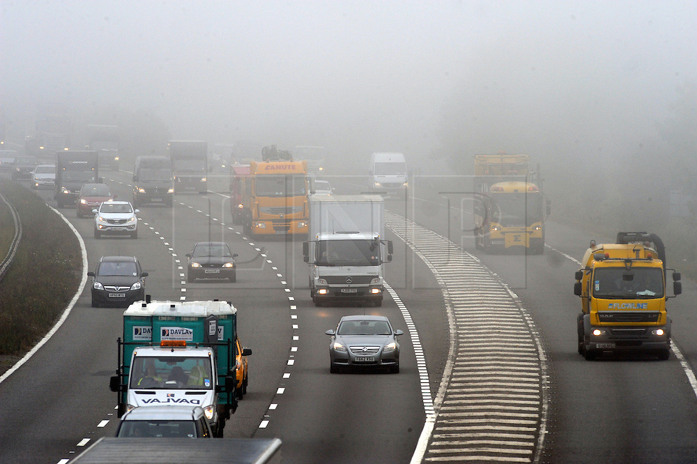 © Licensed to London News Pictures. 16/09/2014<br /> A foggy morning for drivers today(16.09.2014)<br />  Foggy driving conditions this morning on the M25 at Swanley in Kent Traffic clock-wise into Kent.<br /> (Byline:Grant Falvey/LNP)