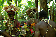 Men in traditional dress perform with traditional instruments, Mclaren Harbour, Tufi, Cape Nelson, Oro Province, Papua New Guinea