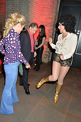 Left to right, VISCOUNT & VISCOUNTESS LINLEY and COUNTESS DORA della GHERARDESCA at a Night of Disco in aid of Save The Children held at The Roundhouse, Chalk Farm Road, London on 5th March 2015.
