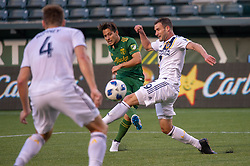 June 15, 2018 - Portland, Oregon, U.S. - PORTLAND, OR - JUNE 15: Portland Timbers midfielder Sebasti‡n Blanco takes a shot on goal past LA Galaxy midfielder Chris Pontius during the Portland Timbers game versus the LA Galaxy in a United States Open Cup match on June 15, 2018, at Providence Park, OR. (Photo by Diego G Diaz/Icon Sportswire) (Credit Image: © Diego Diaz/Icon SMI via ZUMA Press)