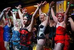 © Licensed to London News Pictures. 13/02/2016. London, UK. Participants taking part at world's largest burlesque glove peel relay record attempt at Clapham Grand in London on Saturday, 13 February 2016. Organised by Sapphira, founder of a burlesque academy, the event is a tribute to Sir Richard Branson after they were given discount on their flights to tour from Australia to England. Photo credit: Tolga Akmen/LNP