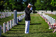 Marine Lt. Col. Cal Worth salutes as he visits the gravesite of a fallen comrade during a Memorial Day visit to Arlington National Cemetery in Arlington Virginia, USA on 27 May, 2013.