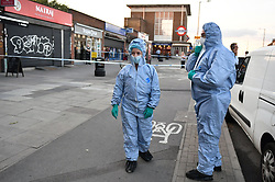 © Licensed to London News Pictures. 21/08/2018. London, UK. Forensics at the scene of a double shooting in Rayners Lane, Harrow, north London. Armed police are reported to be searching the area after two men were shot in broad daylight. Their condition is unknown. This follows two separate shooting incidents in London yesterday. Photo credit: Ben Cawthra/LNP