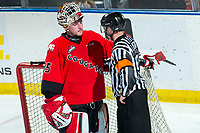 KELOWNA, BC - DECEMBER 30: Referee Mike Langin speaks to Taylor Gauthier #35 of the Prince George Cougars during third period against the Kelowna Rockets  at Prospera Place on December 30, 2019 in Kelowna, Canada. (Photo by Marissa Baecker/Shoot the Breeze)