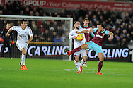 Leon Britton of Swansea city challenges Mark Noble of West Ham Utd (r). Barclays Premier league match, Swansea city v West Ham Utd at the Liberty Stadium in Swansea, South Wales  on Sunday 20th December 2015.<br /> pic by  Andrew Orchard, Andrew Orchard sports photography.