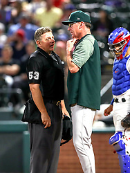 April 23, 2018 - Arlington, TX, U.S. - ARLINGTON, TX - APRIL 23: Oakland Athletics manager Bob Melvin chats with home plate umpire Greg Gibson during the game between the Texas Rangers and the Oakland Athletics on April 23, 2018 at Globe Life Park in Arlington, Texas. (Photo by Steve Nurenberg/Icon Sportswire) (Credit Image: © Steve Nurenberg/Icon SMI via ZUMA Press)