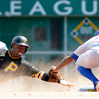 Pittsburgh Pirates center fielder Andrew McCutchen (22) slides pass second base and is out as Los Angeles Dodgers left fielder Howie Kendrick (47) applies the tag seventh inning  at PNC Park on June 27, 2016 in Pittsburgh.  Photo by Archie Carpenter/UPI