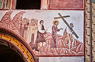 Pictures & images of the Byzantine fresco panels in the Gelati Georgian Orthodox Church of the Virgin, 1106, depicting a scene from the Passion of Christ in whch Simon of Cyrene helps carry the cross.  The medieval Gelati monastic complex near Kutaisi in the Imereti region of western Georgia (country). A UNESCO World Heritage Site. .<br /> <br /> Visit our MEDIEVAL PHOTO COLLECTIONS for more   photos  to download or buy as prints https://funkystock.photoshelter.com/gallery-collection/Medieval-Middle-Ages-Historic-Places-Arcaeological-Sites-Pictures-Images-of/C0000B5ZA54_WD0s<br /> <br /> Visit our REPUBLIC of GEORGIA HISTORIC PLACES PHOTO COLLECTIONS for more photos to browse, download or buy as wall art prints https://funkystock.photoshelter.com/gallery-collection/Pictures-Images-of-Georgia-Country-Historic-Landmark-Places-Museum-Antiquities/C0000c1oD9eVkh9c