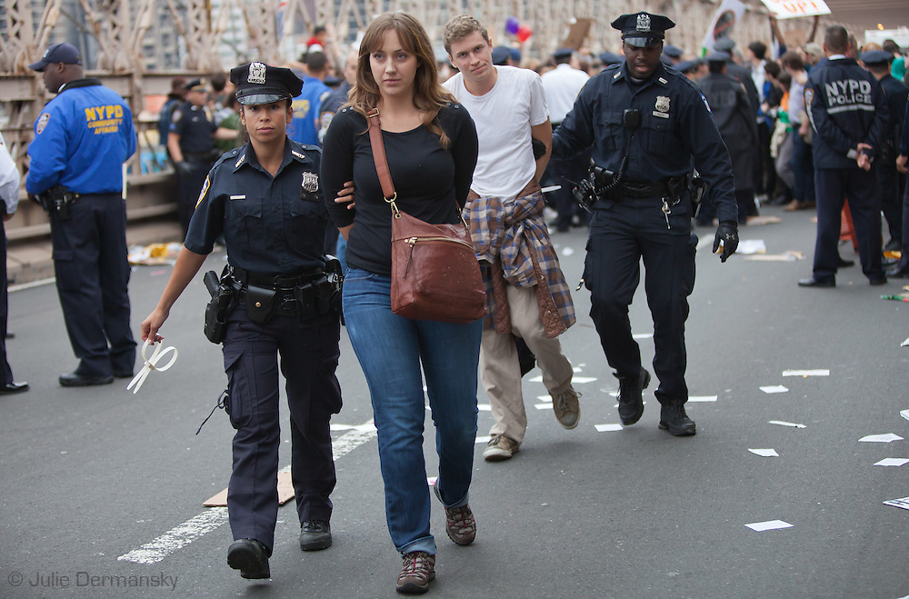New York City, NY, Oct. 1, 2011, The 15th Day of Occupy Wall Street police arrest a protestor on the Brooklyn Bridge .Hundreds of participants in the 'Occupy Wall Street' movement  were penned and arrested and later issued tickets and let out of jail with an assigned court date.