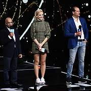 Lord Rumi Verjee, Pixie Lott and Kees Kruythoff On stage attend WE Day UK at Wembley Arena, London, Uk 6 March 2019.