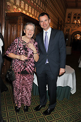 Secretary of State for Health JEREMY HUNT MP and SISTER MARY OWENS at a gala dinner in aid of Nyumbani the Hot Courses Foundation held in The Members Dining Room,  The House of Commons, London on  7th March 2013.