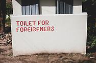 Kyaiktiyo, Myanmar - October 30, 2011: A misspelled sign indicating the toilet for foreigners in Kyaiktiyo, Myanmar.