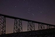 Salisbury Mills, NY - The constellation Orion rises over the Moodna Viaduct railroad bridge at twilight on Thursday, Jan. 14, 2010.