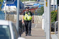 ©Licensed to London News Pictures 22/04/2020  <br /> Chatham, UK. A policeman walking towards the blocks of flats on The Quays. Police on guard outside the block of flats. A man has been arrested by armed police this morning in Chatham, Kent after wielding guns on a balcony at a Dockside flat. Photo credit:Grant Falvey/LNP