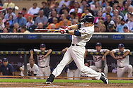 Justin Morneau #33 of the Minnesota Twins connects for a home run against the Chicago White Sox on June 19, 2013 at Target Field in Minneapolis, Minnesota.  The Twins defeated the White Sox 7 to 4.  Photo: Ben Krause