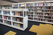 Book shelves with integrated lighting inside the library of the Hive in Worcester, UK. The first fully integrated university and public library in the UK. It houses the county archives and archaeology service, the local history centre and is also a local authority hub. The building is low energy.