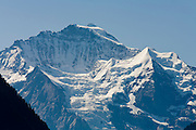 01 AUGUST 2007 -- INTERLAKEN, BERN, SWITZERLAND: The peak of the Jungfrau mountain as seen from Interlaken, Switzerland. Interlaken, in the canton of Bern, is the heart of the Bernese Oberland and the center of the region's tourism industry.   PHOTO BY JACK KURTZ