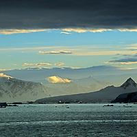 The sun rises over Anvers Island, near the Antarctic Peninsula.