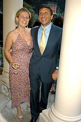 The HON.SIR ROCCO & LADY FORTE at the Tatler Summer Party in association with Moschino at Home House, 20 Portman Square, London W1 on 29th June 2005.<br />