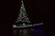 Boats decorated with holiday lights make their way through Charleston harbor during the annual Parade of Boats December 3, 2011 in Charleston, South Carolina.