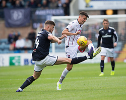 Dundee's Kerr Waddell and Ross County's Tim Chow. half time : Dundee 0 v 1 Ross County, Scottish Premiership game played 5/8/2017 at Dundee's home ground Dens Park.