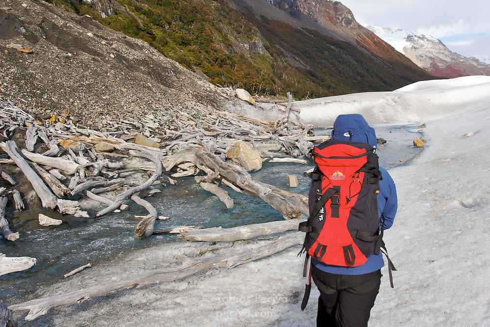 A mountain guide leads the way on a hike on the Perito Moreno Glacier. The glacier is a popular hiking destination in Los Glaciares National Park, Argentina.