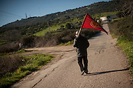 A man with a Navarre flag walsk towards the prison. Caceres (Spain). February 20, 2016. Some friends and relatives of Basque political prisoners take part on a march to Caceres penitentiary center, within the campaign of 40 marches to 40 prisons where Basque prisoners are imprisoned. These marches are to denounce the dispersal policy those prisoners suffer since more than 25 years. (Gari Garaialde / Bostok Photo)