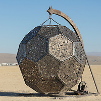 """The InnerSun Project<br /> by: The InnerSun Crew<br /> from: The World<br /> year: 2019<br /> <br /> This monumental art structure is an eight-story wooden globe gently cradled by a giant pair of hands. Within, the space is lit by a sacred light: the InnerSun. A series of wheelchair accessible ramps wind up the curved walls to an equatorial terrace, where participants will gather inside the sphere.<br /> <br /> The InnerSun Project: A global art collaboration. Each massive hand on the structure is comprised of individual human-sized hands with messages from across the world written on them — our collective answer to """"what's your InnerSun?"""" In this way, thousands of people from anywhere in the world can take part in the artwork itself.<br /> <br /> Many hands, one light, a better world.<br /> <br /> URL: http://www.theinnersun.org<br /> Contact: hello@theinnersun.org<br /> Donate To This Project<br /> <br /> https://burningman.org/event/brc/2019-art-installations/?yyyy=&artType=B#a2I0V000001AXiaUAG My Burning Man 2019 Photos:<br /> https://Duncan.co/Burning-Man-2019<br /> <br /> My Burning Man 2018 Photos:<br /> https://Duncan.co/Burning-Man-2018<br /> <br /> My Burning Man 2017 Photos:<br /> https://Duncan.co/Burning-Man-2017<br /> <br /> My Burning Man 2016 Photos:<br /> https://Duncan.co/Burning-Man-2016<br /> <br /> My Burning Man 2015 Photos:<br /> https://Duncan.co/Burning-Man-2015<br /> <br /> My Burning Man 2014 Photos:<br /> https://Duncan.co/Burning-Man-2014<br /> <br /> My Burning Man 2013 Photos:<br /> https://Duncan.co/Burning-Man-2013<br /> <br /> My Burning Man 2012 Photos:<br /> https://Duncan.co/Burning-Man-2012"""