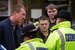 © Licensed to London News Pictures . FILE PICTURE DATED 09/06/2012 of EDL Leaders Kevin Carroll (l) and Stephen Yaxley-Lennon ( aka Tommy Robinson ) (r) at an EDL demonstration in Rochdale as today (8th October 2013) Yaxley-Lennon and co-leader Kevin Carroll have announced they are leaving the group . Photo credit : Joel Goodman/LNP